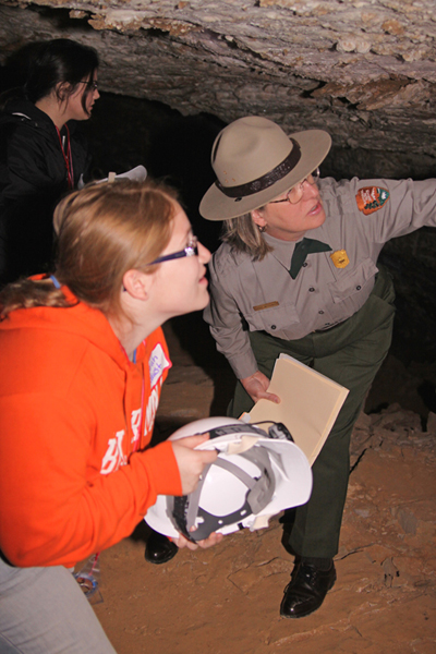 Ranger shows teacher-students differences in gypsum formations - why do gypsum crystals sugar-coat the cave walls in one place and jut out in curls in another?