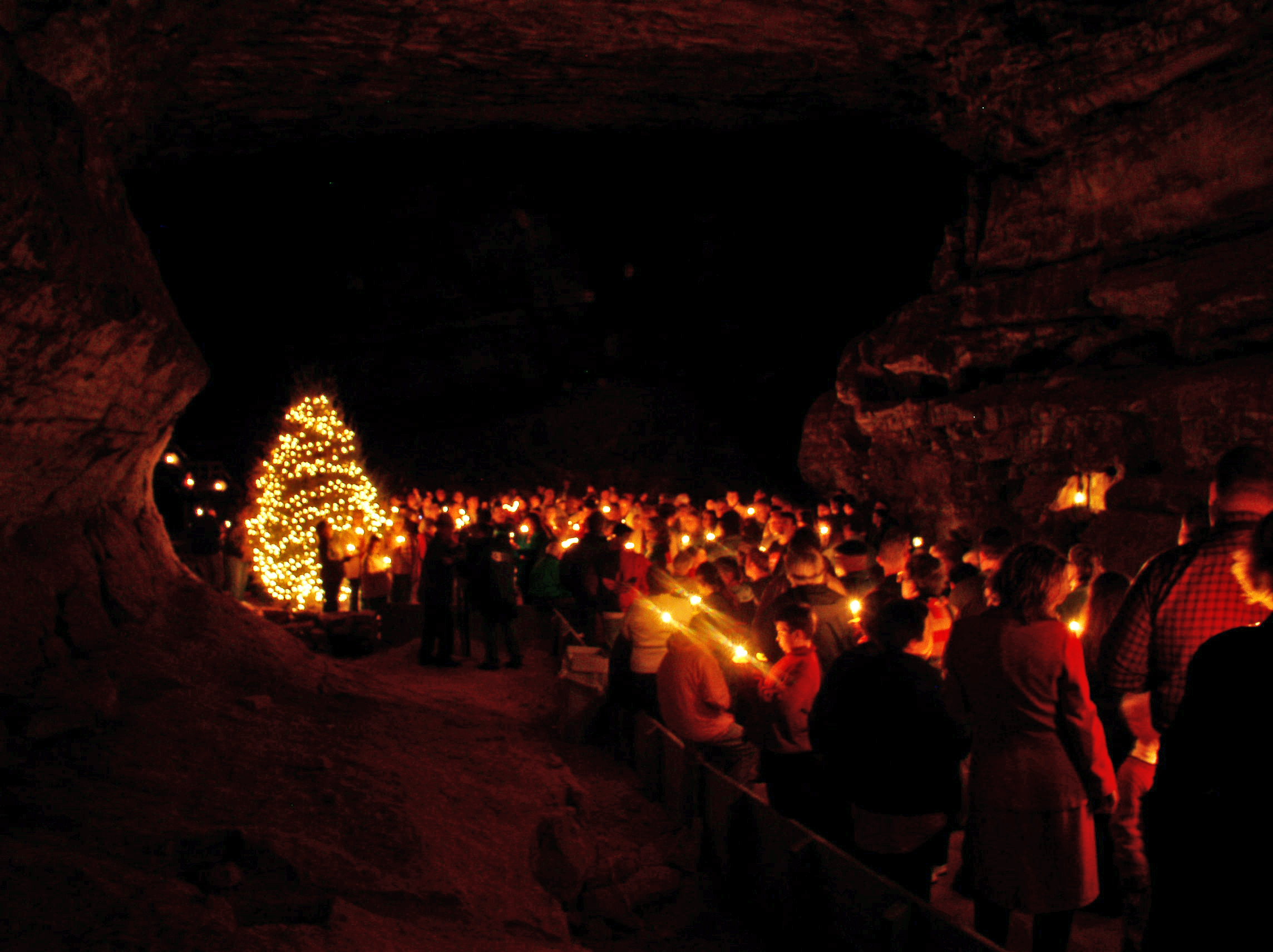 visitors see Mammoth Cave by candle light