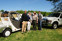 Officials with electric- and propane-powered vehicles