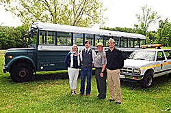 Superintendent Reed and others with alternative fuel vehicles