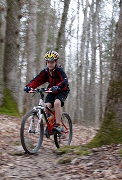 A boy rides a mountain bike in the forest in Mammoth Cave National Park