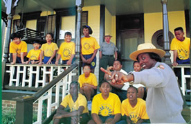 Park ranger makes a point with a class of schoolchildren at the Birth Home.