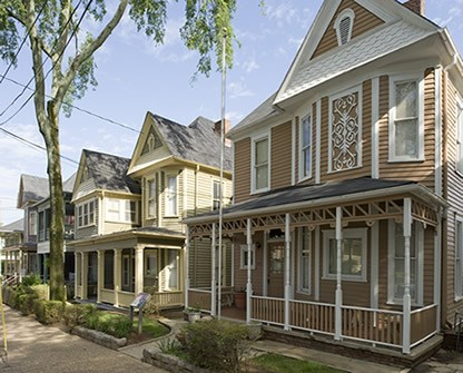 Row of Queen Anne homes.