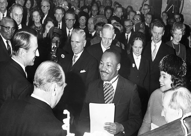 Dr. Martin Luther King, Jr. shakes hand of King Olav of Norway at prize ceremony in Oslo.