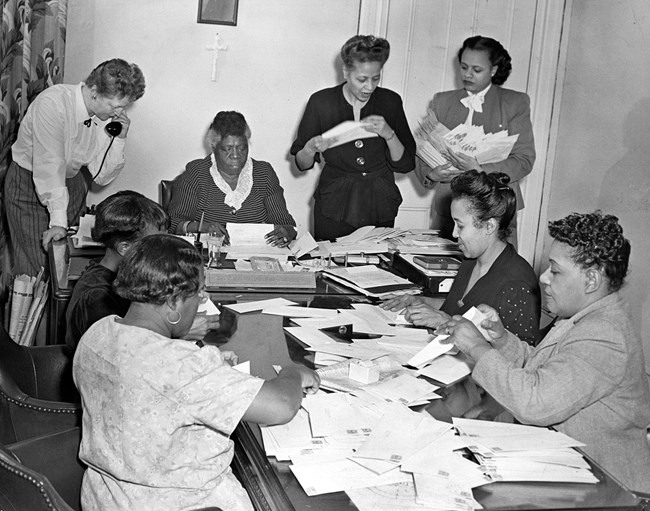 Mrs. Bethune and NCNW members preparing mailout