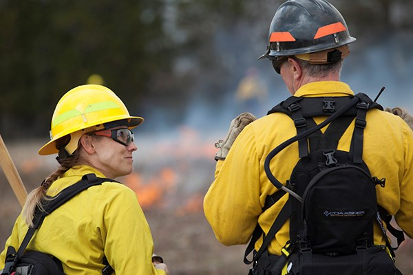 Firefighters work on a prescribed fire