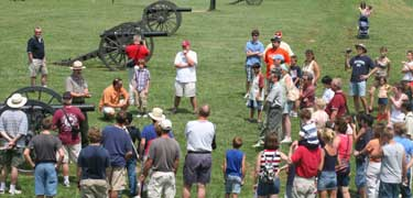 Ranger Jim Burgess leading a tour along Ricketts' Battery.