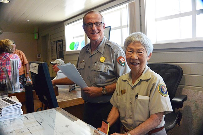 Volunteer assisting ranger at front desk