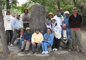 The Nishi family and other volunteers gather in front of one of the cornerstones of Merritt Park.