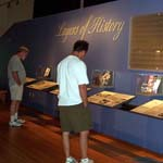 People in visitor center reading exhibit