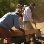 volunteers working at an archeological dig