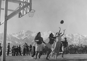 Girls playing basketball at Manzanar
