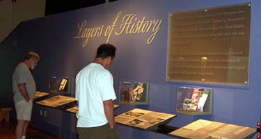 Two men reading exhibit panel in Visitor Center