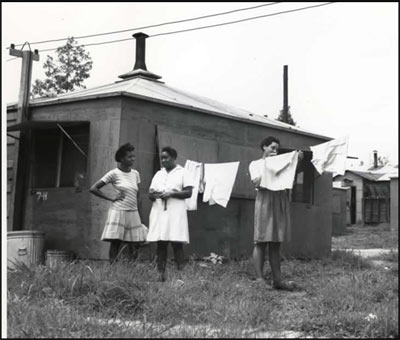 African-American females hang laundry
