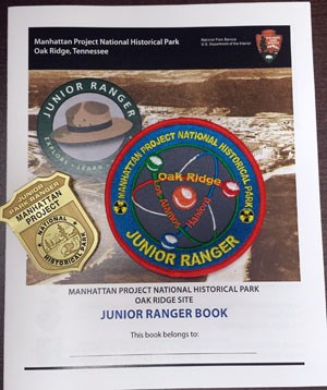 booklet, patch, and badge