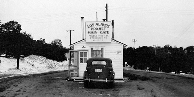 historic image of the entrance gate at the Los Alamos site