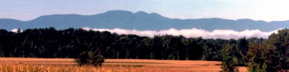 Mist rises over fields on Martin Van Buren's farm Lindenwald as the Catkill Mountains loom in the distance.