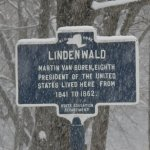 A state historic marker on on a snowy day on Old Post Road in front of Lindenwald.