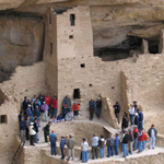 Visitors encircle a kiva at Cliff Palace