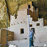 Photographer/Archeologist in Cliff Palace