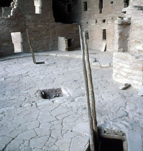 Cliff dwelling courtyard with kiva entrances