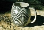 White mug with black, painted geometric designs