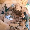 Mesa Verde archeologists help document a cliff dwelling in Glen Canyon National Recreation Area.