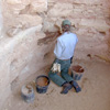 Park ranger archeologist repairs a kiva wall in Long House.