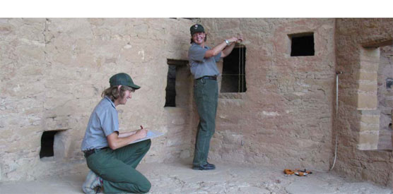 Two archeologists working in Spruce Tree House.