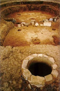 Early pithouse (semi-subterranean home) with antechamber in the foreground.  A.D. 650.
