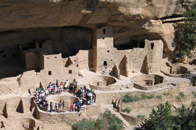 Visitors encircling Kiva F during a ranger-guided tour of Cliff Palace