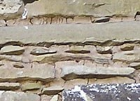 Example of chinking in stone and mortar wall
