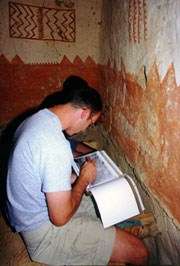 A student documents plaster in Cliff Palace.