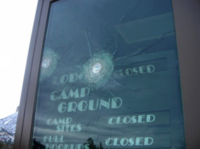 Damage from shots fired at entrance gate