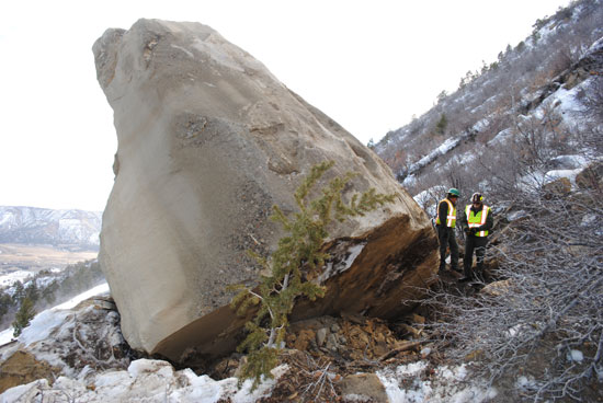 Park staff checking the stability of the 240-ton boulder before blast.