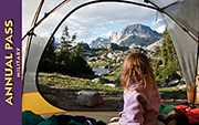 2014 Interagency Military Annual Pass. Child looking out of tent at mountain scene.