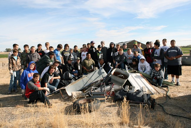 Buhl 8th Grade Students volunteer to clean up the Fire Station area out at Minidoka NHS.