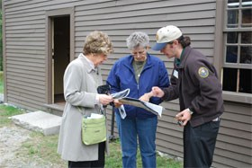 "Park volunteer assisting visitors at one of the park's April 19, 1775 ""witness"" houses"