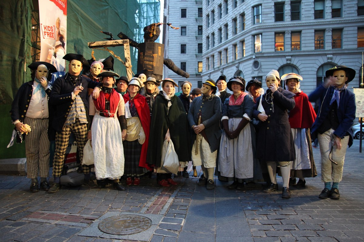 men and women in working class colonial garments