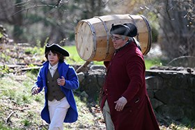 man and son carry a barrel