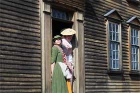 Colonial women at Barrett Farm await the British