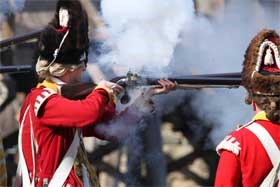 British Grenadier fires his musket