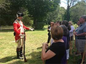 British reenactor leads teachers in a Revolutionary War military drill activity