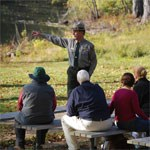 A park ranger giving a talk at North Bridge