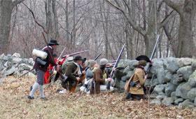 colonial militia take cover behind a wall