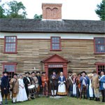 Captain William Smith House with living history volunteers representing the Lincoln Minute Men