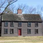 Two story dark gray colonial house