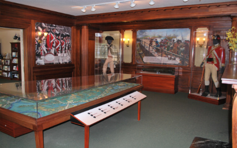 Exhibit case and interpretive panels at the North Bridge Visitor Center, Minute Man National Historical Park.