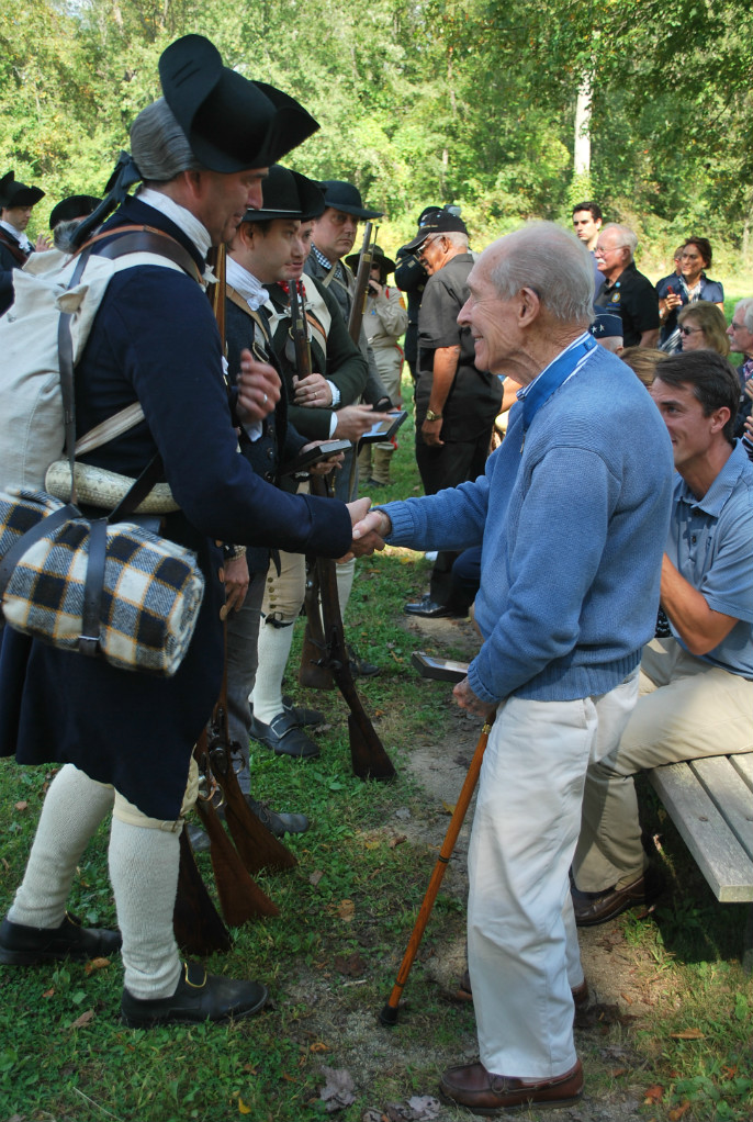Captain Thomas Hudner shakes hands with historian and park volunteer Joel Bohy