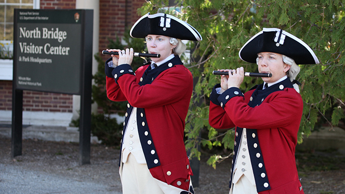 Musicians of the Old Guard perform outside North Bridge Visitor Center.
